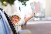Female tourist traveling in car — Stock Photo