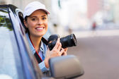 Young woman photographing from car — Stock Photo