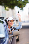 Tourist with camera inside car — Stock Photo