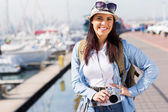 Young woman touring at harbour — Stock Photo