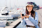 Female tourist at the harbour — Stock Photo
