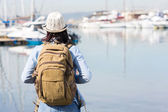 Female tourist by the harbor — Stock Photo