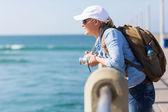 Traveller standing on pier — Stock Photo