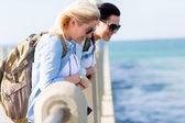 Travelers standing on beach pier — Stock Photo