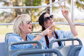 Young tourists on tour bus — Stock Photo