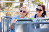 Female tourists on bus — Stock Photo