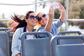 Tourists taking selfie with phone — Stok fotoğraf
