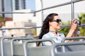 Traveller taking video of city — Stock Photo