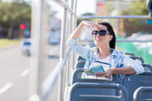 Young woman touring the city — Stock Photo