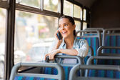 Female commuter talking on phone — Stock Photo