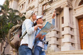 Tourists looking at historical building — Stock Photo