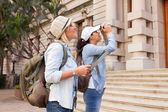 Tourists photographing historical building — Stock Photo