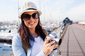 Attractive tourist with camera — Stock Photo