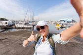 Happy tourist taking self portrait — Stock Photo