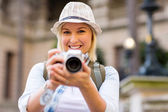 Female tourist taking picture — Stock Photo