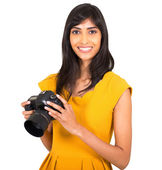 Indian woman holding camera — Stock Photo