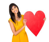 Indian woman presenting heart shape — Stock Photo