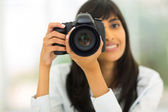 Female photographer taking photos — Foto de Stock