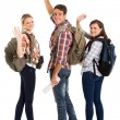 Group of young tourists waving goodbye — Stock Photo #49816117