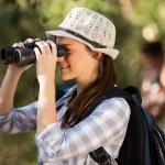 Woman using binoculars bird watching — Stock Photo #49816527