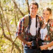 Young couple hiking in autumn forest — Stock Photo #49817243