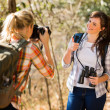 Woman taking photos of her friend — Stock Photo #49818823