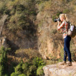 Female photographer taking photos on mountain — Stock Photo #49819953