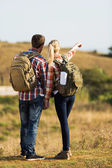Hikers pointing at distance — Stock Photo