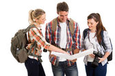 Group of tourists checking directions on map — Stock Photo