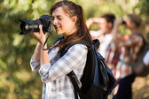 Photographer taking pictures in nature — Stock Photo