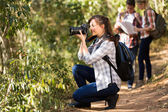 Woman taking photos during hiking trip — Stock Photo