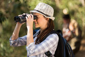 Woman using binoculars bird watching — Stock fotografie