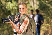 Woman holding dslr camera outdoors — Stock Photo