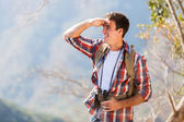 Young man on top of mountain — Stock Photo