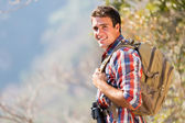 Young man in autumn mountain — Stock Photo