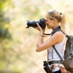 Female photographer taking photos in mountain — Stock Photo #49820899