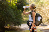 Young hiker drinking water  — Photo