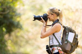 Female photographer taking photos in mountain — Stock Photo