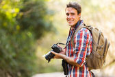 Man hiking with dslr camera — Stock Photo