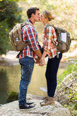 Young couple kissing in mountain valley — Stock Photo