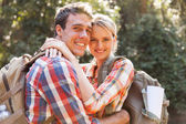Young couple hugging in the forest — Stock Photo