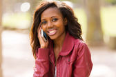 African girl talking on cell phone — Stock Photo