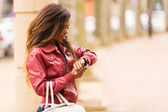 African woman looking at watch — Stock Photo