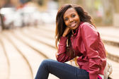 African woman relaxing in urban city — Stock Photo