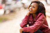 Young african woman daydreaming — Stock Photo