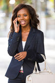 African woman talking on mobile phone — Stock Photo