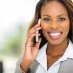 Black businesswoman talking on mobile phone — Stock Photo #50599591