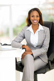 African female business executive in office — Stock Photo