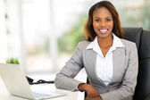 Young afro american businesswoman sitting in office — Stock Photo