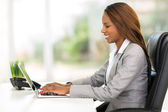 African office worker using laptop computer — Stock Photo